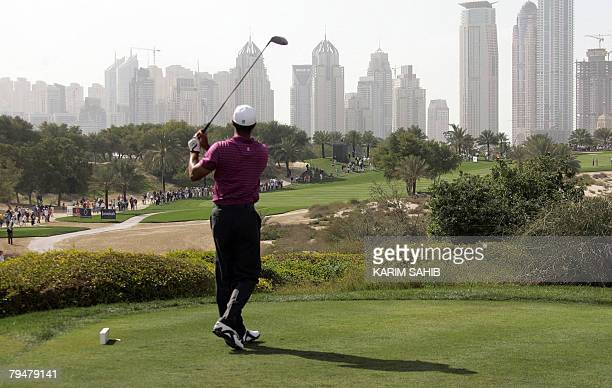 US ace golfer Tiger Woods plays the 8th fairway during the 3rd round of the Dubai Desert Classic at the Emirates Golf Club in Dubai 02 February 2008...