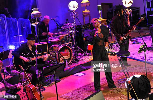 Ace Mark Richardson Skin and Cass of Skunk Anansie perform on stage during the band's first ever Unplugged concert at Cadogan Hall on April 15 2013...