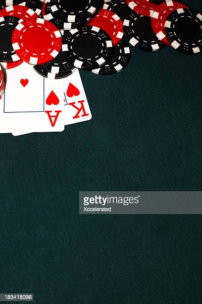 ace of hearts and king of hearts with pile of poker chips - texas hold 'em stock pictures, royalty-free photos & images