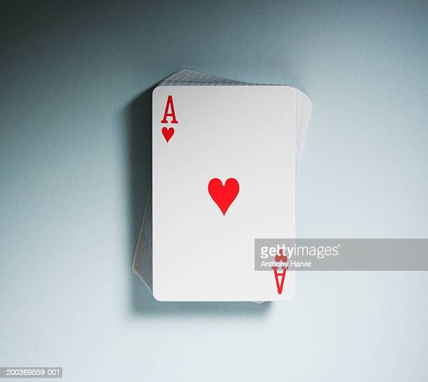 Ace of Hearts on top of pack of playing cards, close-up