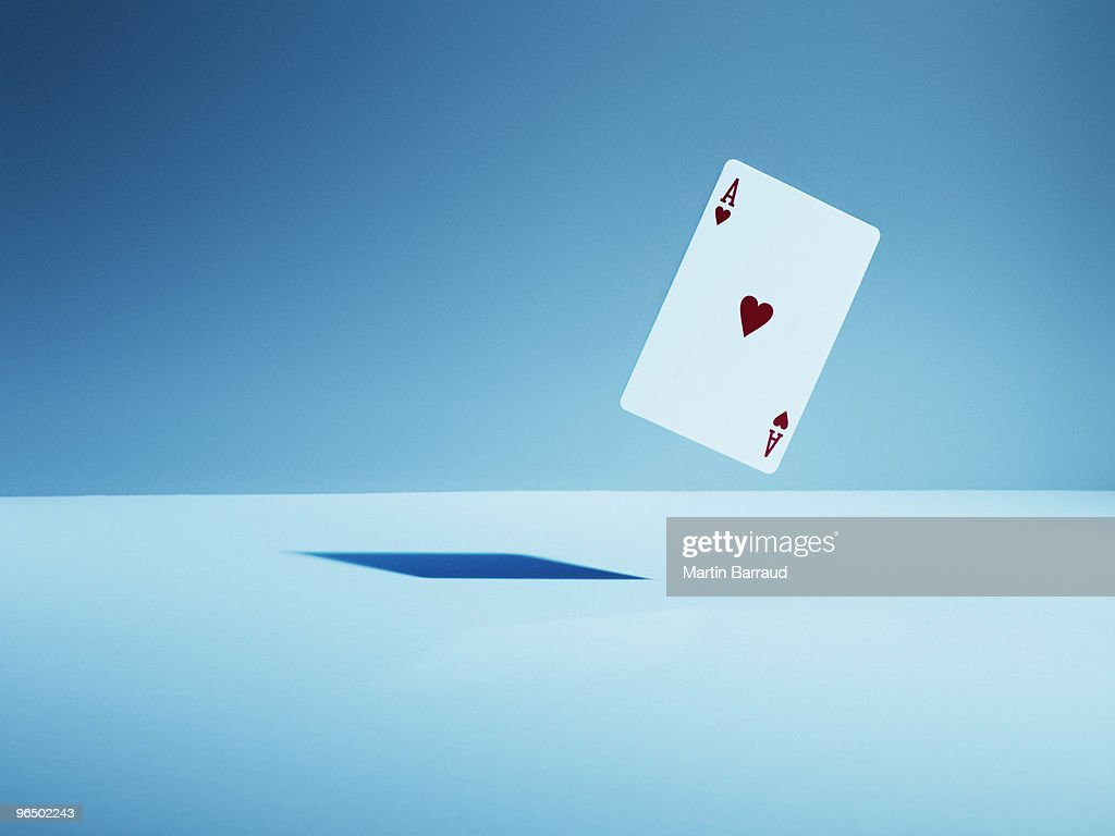 Ace of hearts playing card in mid-air : Stock Photo