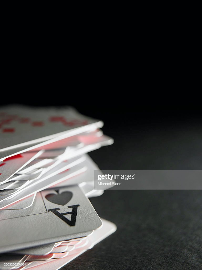 Ace of spades in stack of playing cards, close-up : Stock Photo