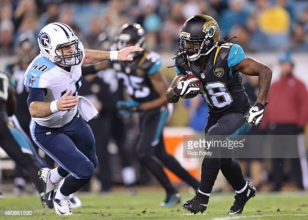 Ace Sanders of the Jacksonville Jaguars carries as Beau Brinkley of the Tennessee Titans defends during the game at EverBank Field on December 18...