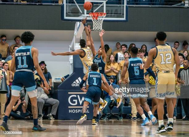 Ace Stallings of George Washington shoots over Jacob Toppin of Rhode Island during a game between Rhode Island and George Washington at Charles E...