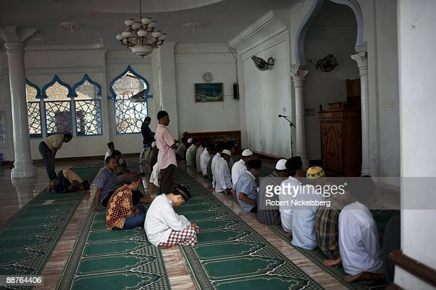 Acehnese men attend midday prayers at a local mosque in Aceh province's capital city June 15 2009 Following the December 26 2004 tsunami which...