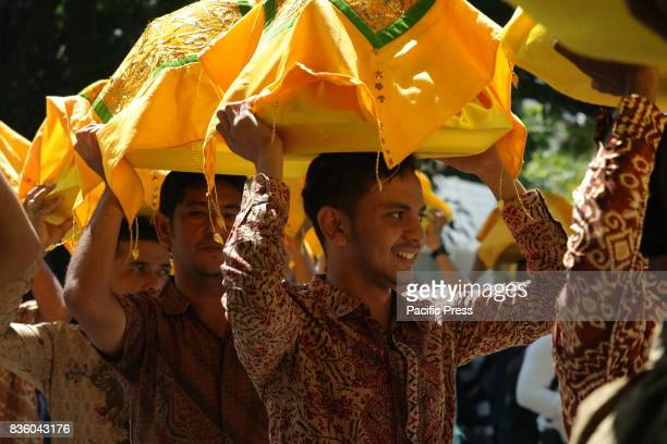 Acehnese men carry 1074 trays of traditional food above his head during the Aceh International Halal Food Festival Held in Banda Aceh City Aceh...