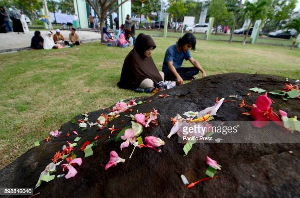 Acehnese people are commemorating the 13th anniversary of the tsunami in the Ulee Lheu mass grave Aceh Aceh is one of the worst areas hit by a 92...