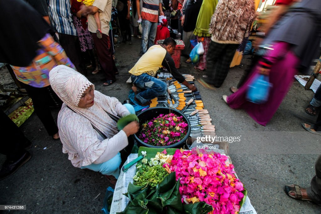"Acehnese people crowded the market to buy meat at the traditional Lhokseumawe market before celebrating the Eid-ul-Fitr festival called the ""Meugang"" tradition, Aceh, Indonesia, on June 14, 2018, Aceh. Muslims around the world will celebrate the Idul Fitri festival after the holy month of Ramadan, where they refrain from sexual activity, eating and drinking from sunrise to sunset."