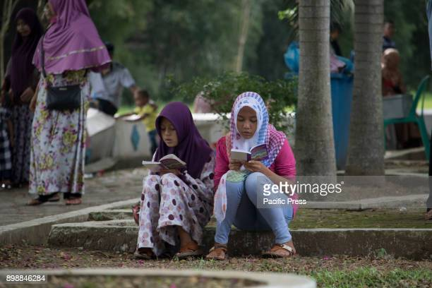 Acehnese people praying in the mass grave of Siron Aceh Besar Regency Aceh Province In the cemetery there were more than 40 000 bodies of tsunami...