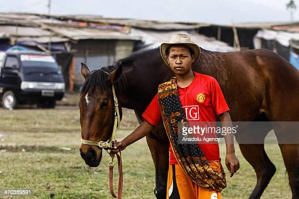 Acehnese teen preparing for the competition during the annual traditional horse race in Takengon Central Aceh Indonesia February 19 2014 Horse racing...