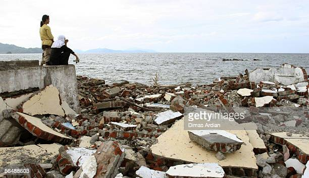 Acehnese tsunami survivors take in the view at Ulhe Lheue beach a densely populated area before the tsunami December 26 2005 in Banda Aceh Indonesia...