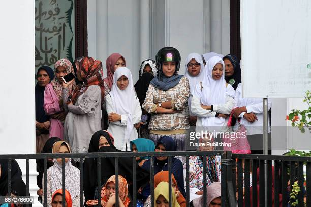 Acehnese watch the being whipped in public for violating sharia law on May 23 2017 in Banda Aceh Indonesia About four Acehnese couple received 25 up...