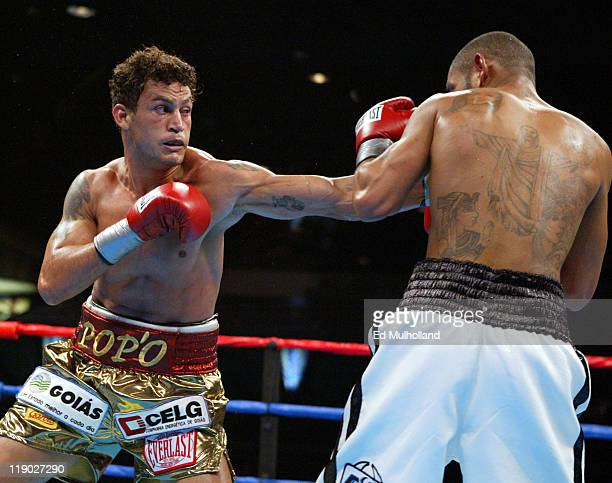 Acelino Freitas lands a left to the head of Diego Corrales during their WBO Lightweight Championship bout at Foxwoods Casino Corrales won the title...