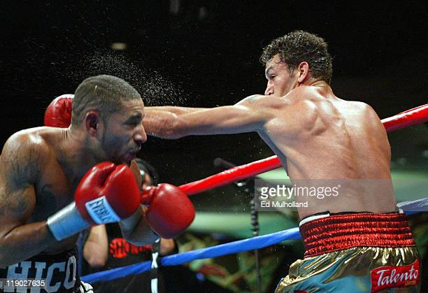 Acelino Freitas lands a right jab to the head of Diego Corrales during their WBO Lightweight Championship bout at Foxwoods Casino Corrales won the...