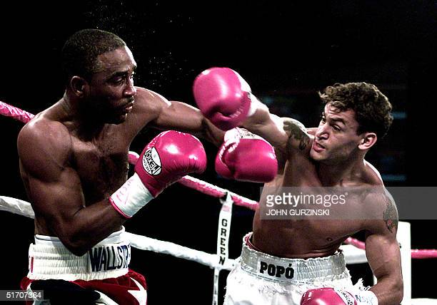 Acelino Freitas of Salvador, Brazil throws a right to the head of Joel Casamayor, of Miami Lakes, Florida in the fifth round at the Cox Pavilion in...