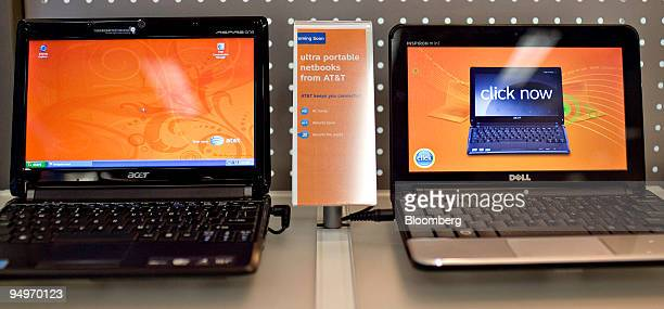 Acer left and Dell netbooks sit on display inside an ATT store in New York US on Thursday July 23 2009 ATT Inc Verizon Communications Inc and Sprint...