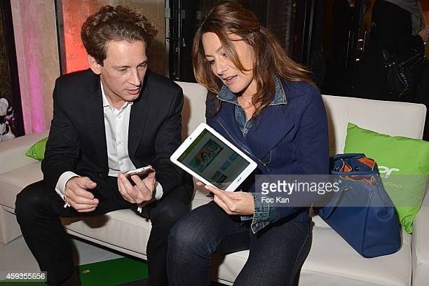 Acer Marketing director Fabrice Massin and Shirley Bousquet attend the Acer Pop Up Store Launch Party at Les Halles on November 20, 2014 in Paris,...