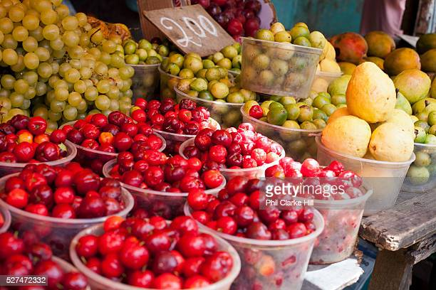 Acerola fruit in market mercado Sao Jaoquim Salvador Bahia Brazil