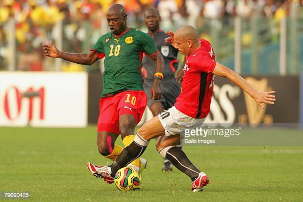 Achille Emama of Cameroon competes with Wael Gomaa Kamel Elhawty of Egypt during the AFCON Final between Egypt and Cameroon at the Ohene Djan stadium...