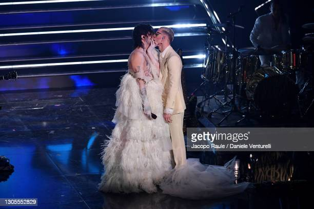 Achille Lauro and Boss Doms kiss on stage during the 71th Sanremo Music Festival 2021 at Teatro Ariston on March 05, 2021 in Sanremo, Italy.