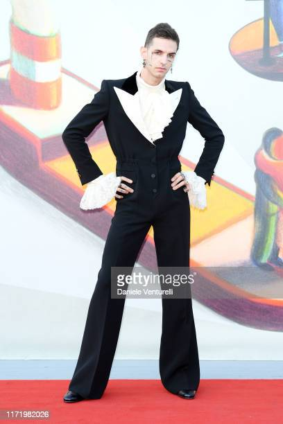 Achille Lauro walks the red carpet ahead of the Happy Birthday screening during the 76th Venice Film Festival at Sala Giardino on September 03 2019...
