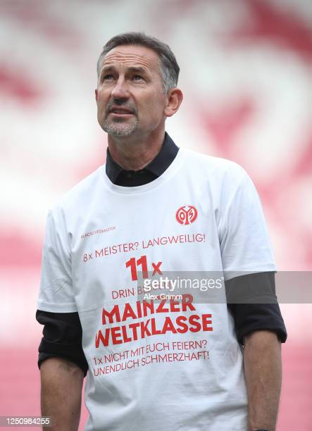 Achim Beierlorzer, head coach of Mainz looks on his teams victory at the final whistle of the Bundesliga match between 1. FSV Mainz 05 and SV Werder...