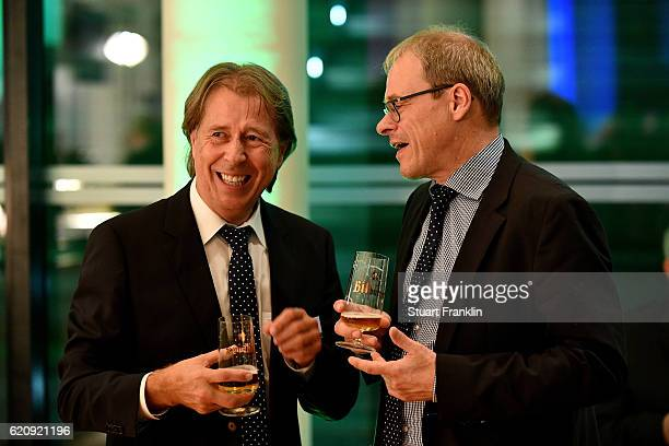Achim Spaeth talks to Peter Peters during the ceremonial act of the DFB Bundestag at Theater Erfurt on November 3, 2016 in Erfurt, Germany.
