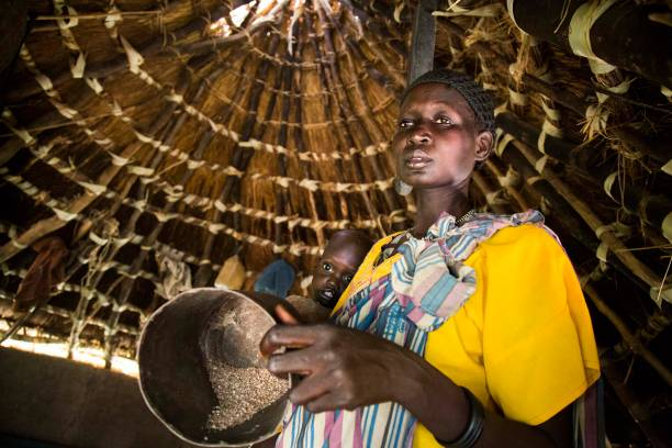 topshot achol ayut holds her malnourished child nyibol lual 2 5