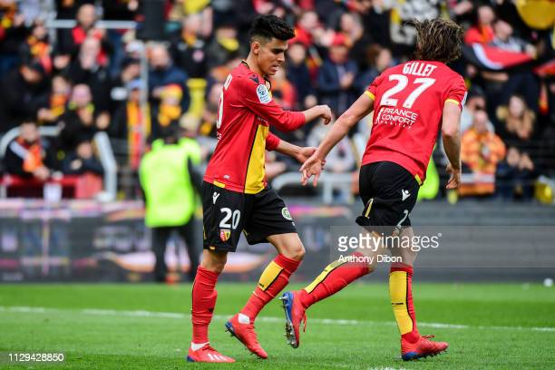Achraf Bencharki and Guillaume Gillet of Lens during the Ligue 2 match between RC Lens and AJ Auxerre at Stade BollaertDelelis on March 9 2019 in...