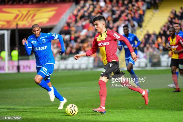 Achraf Bencharki of Lens and Jordan Adeoti of Auxerre during the Ligue 2 match between RC Lens and AJ Auxerre at Stade BollaertDelelis on March 9...