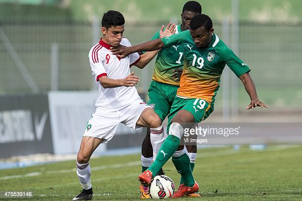 Achraf Bencharki of Morocco U21 Dagou Willie Britto of Cote d'Ivoire U21 Digbo Habib Maiga of Cote d'Ivoire U21 during the Festival International...