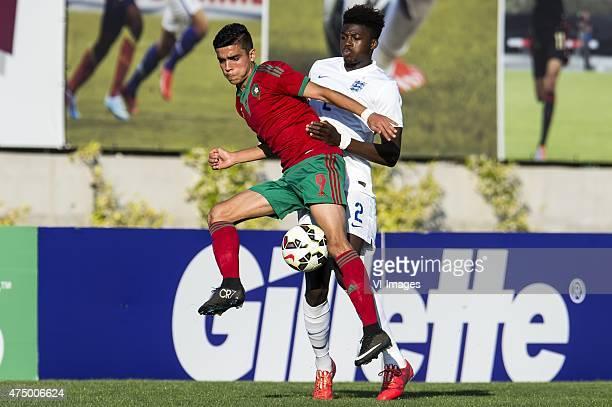 Achraf Bencharki of Morocco U21 Dominic Iorfa of England U21 during the Festival International Espoirs de Football tournament match between...