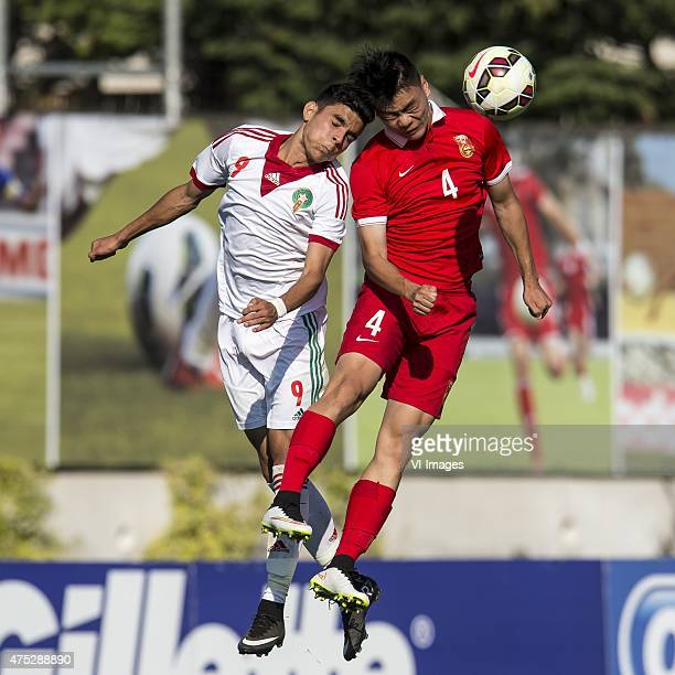 Achraf Bencharki of Morocco U21 Ting Yang of China U21 during the Festival International Espoirs de Football tournament match between China U21 and...