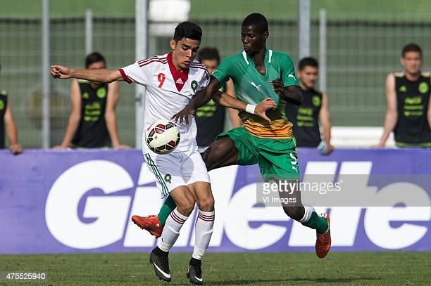 Achraf Bencharki of Morocco U21 Vakoum Issouf Bayo of Cote d'Ivoire U21 during the Festival International Espoirs de Football tournament match...