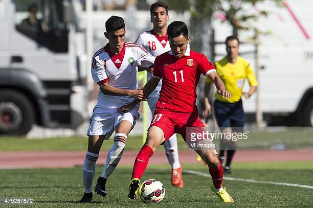 Achraf Bencharki of Morocco U21 Xinghan Wu of China U21 during the Festival International Espoirs de Football tournament match between China U21 and...
