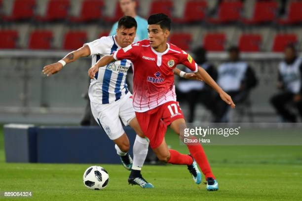 Achraf Bencharki of Wydad Casablanca and Emmanuel Garcia of Pachuca compette for the ball during the FIFA Club World Cup match between CF Pachuca and...