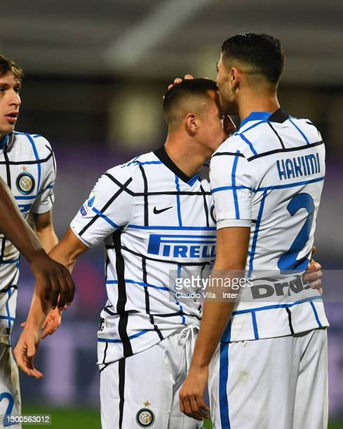 Achraf Hakimi and Alexis Sanchez of FC Internazionale celebrate Ivan Perisic goal during the Serie A match between ACF Fiorentina and FC...
