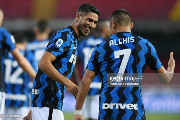 Achraf Hakimi and Alexis Sanchez of FC Internazionale celebrate the 1-4 goal scored by Achraf Hakimiduring the Serie A match between Benevento Calcio...