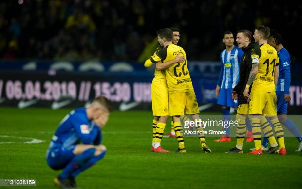 Achraf Hakimi and Christian Pulisic of Borussia Dortmund celebrate the win after the final whistle during the Bundesliga match between Hertha BSC and...