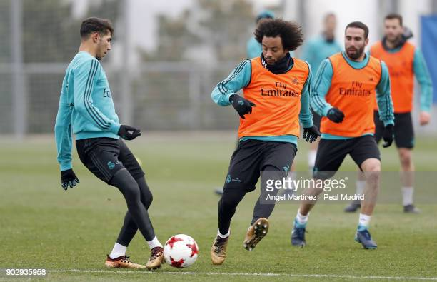 Achraf Hakimi and Marcelo of Real Madrid in action during a training session at Valdebebas training ground on January 9 2018 in Madrid Spain