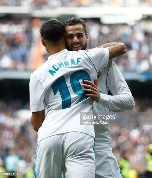 Achraf Hakimi and Nacho Fernandez of Real Madrid celebrate after scoring during the La Liga match between Real Madrid and Sevilla at Estadio Santiago...