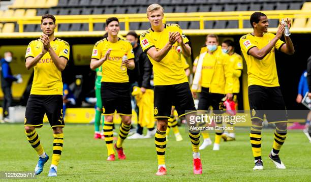 Achraf Hakimi, Leonardo Balerdi, Erling Haaland and Manuel Akanji of Borussia Dortmund celebrate after the Bundesliga match between Borussia Dortmund...