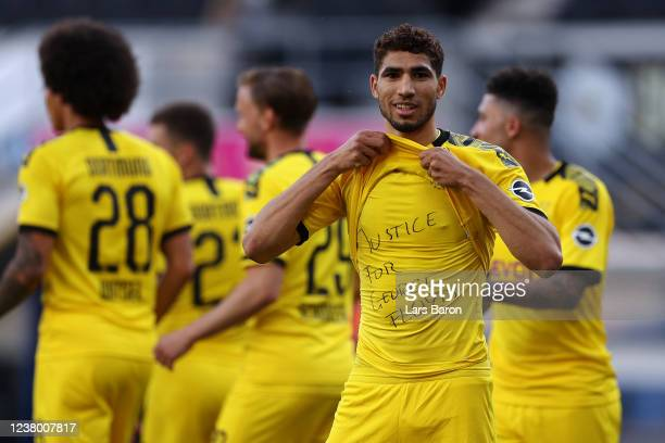 Achraf Hakimi Mouh of Borussia Dortmund celebrates scoring his teams fourth goal of the game with a 'Justice for George Floyd' shirt during the...