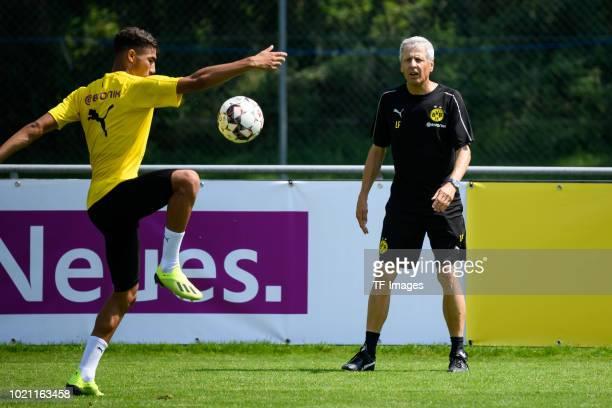 Achraf Hakimi of Borussia Dortmund and Head coach Lucien Favre of Borussia Dortmund in action during the Borussia Dortmund training camp on August 5...