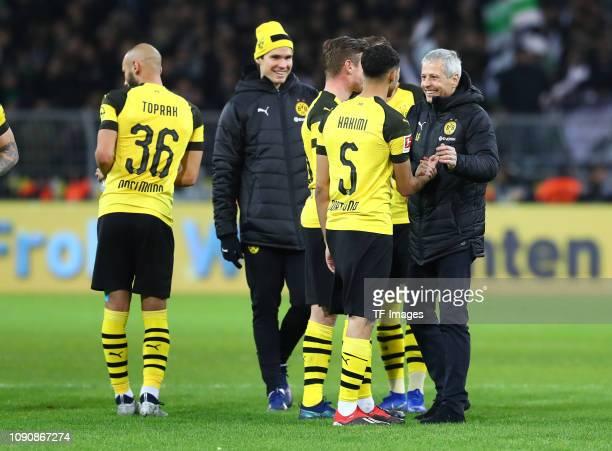 Achraf Hakimi of Borussia Dortmund and head coach Lucien Favre of Borussia Dormund celebrate after winning the Bundesliga match between Borussia...