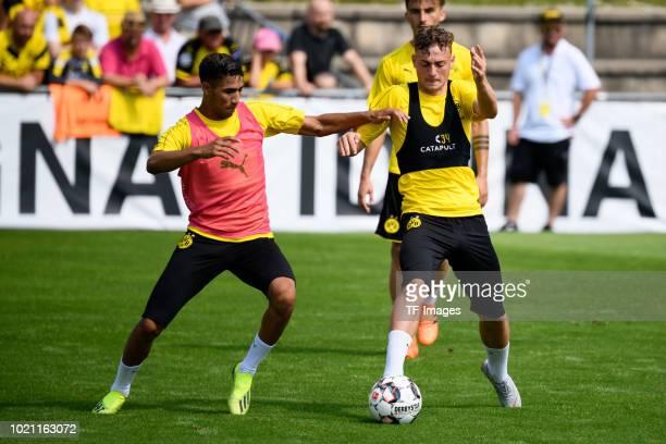 Achraf Hakimi of Borussia Dortmund and Jacob Bruun Larsen of Borussia Dortmund battle for the ball during the Borussia Dortmund training camp on...