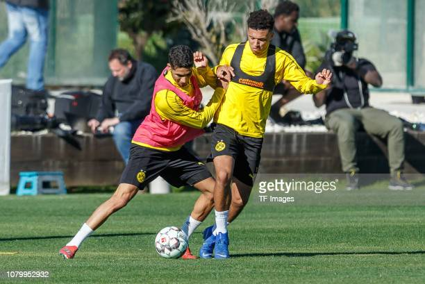Achraf Hakimi of Borussia Dortmund and Jadon Sancho of Borussia Dortmund battle for the ball during a training session as part of the Borussia...