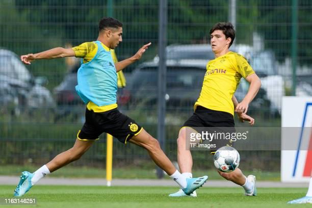 Achraf Hakimi of Borussia Dortmund and Leonardo Balerdi of Borussia Dortmund battle for the ball during the Borussia Dortmund Training Session on...