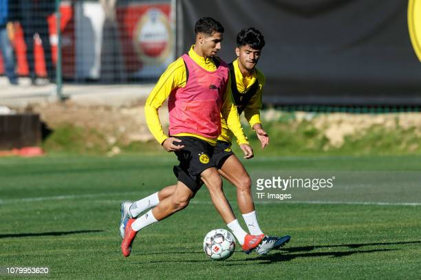 Achraf Hakimi of Borussia Dortmund and Mahmoud Dahoud of Borussia Dortmund battle for the ball during a training session as part of the Borussia...