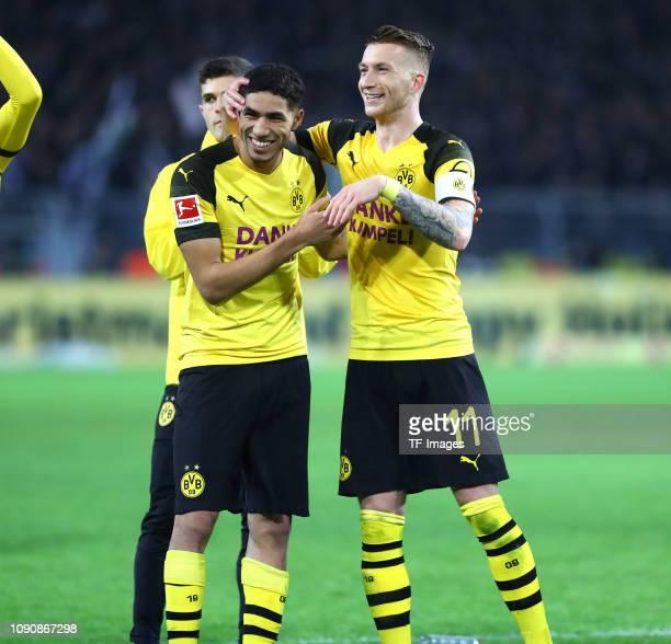 Achraf Hakimi of Borussia Dortmund and Marco Reus of Borussia Dortmund celebrate after winning the Bundesliga match between Borussia Dortmund and...